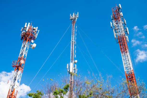 Group of telecommunication tower (such as television broadcast, cellphone etc) with blue sky background.