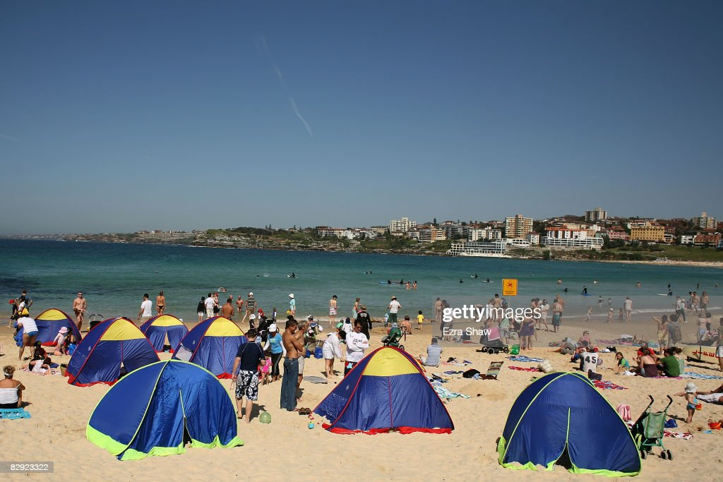 A group of tents for sun protection are set up on Bondi Beach on September 20 & Temperatures Soar As Hot Weather Hits Sydney Photos and Images ...