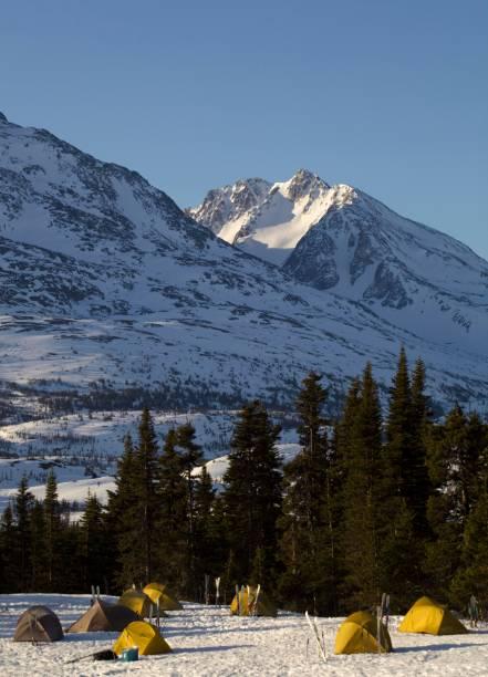 Group of tents, winter camp, White Pass behind, Chilkoot Pass, Chilkoot Trail, British Columbia, B.C., Canada