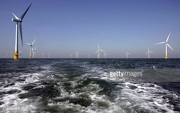 A group of the turbines which form Britain's largest offshore wind farm stand off the Great Yarmouth coastline on July 19 2006 in Norfolk England The...