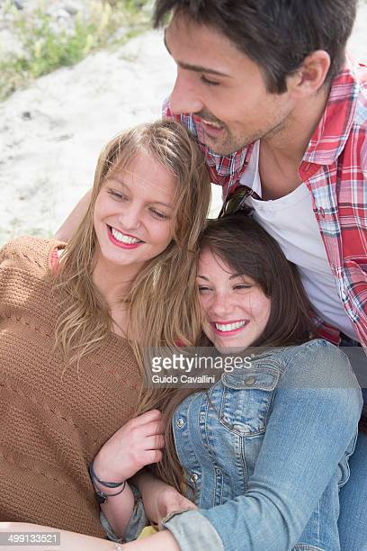 Group of three young adult friends having a laugh