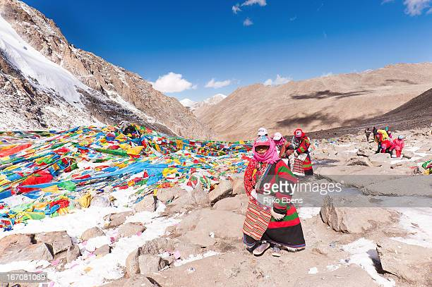 CONTENT] A group of Tibetan pilgrims arrive on top of the Drolma pass during their Kora around Mount Kailash The frozen water and snow are signs of...