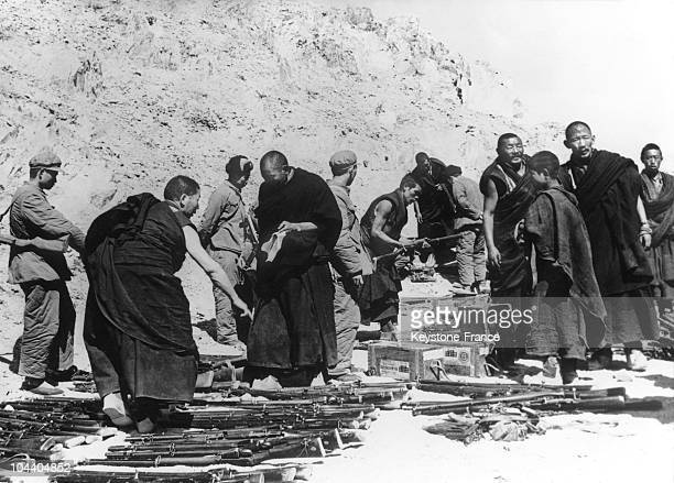 A group of Tibetan rebel women was made prisoner by the Chinese army in Lhasa They are surrending The Khambas tribe rebelled against the Chinese...