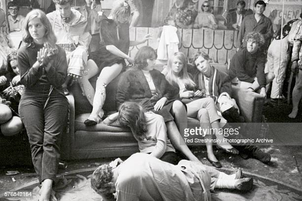 A group of tired partygoers at the Merry Pranksters' Acid Test Graduation most of whom are probably high on LSD25