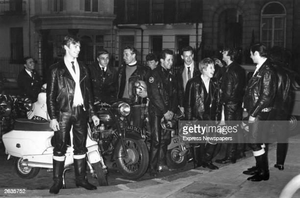A group of 'TonUp' boys standing beside their motorbikes at the Dorchester Hotel London Father William Shergold seen centre