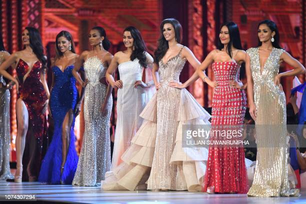 A group of top 10 contestants pose in ther evening gown on stage during the 2018 Miss Universe Pageant in Bangkok on December 17 2018 Miss...