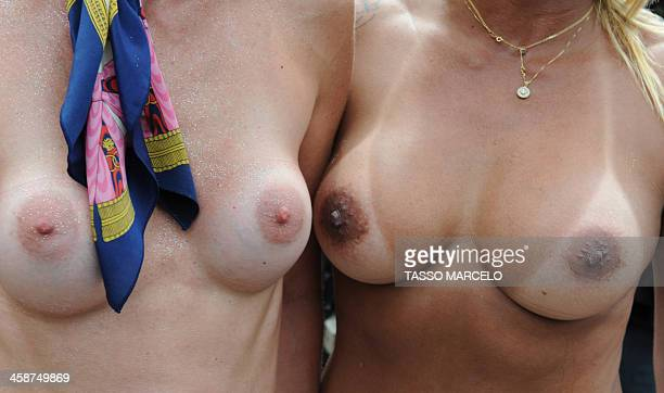 A group of topless women gather on December 21 2013 at Ipanema beach in Rio de Janeiro Brazil to protest against the criminalization of topless AFP...