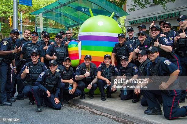 Group of Toronto Police posing during the 36th Pride Celebration