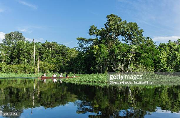 group of tourist in canoe in amazon  river - river amazon stock pictures, royalty-free photos & images
