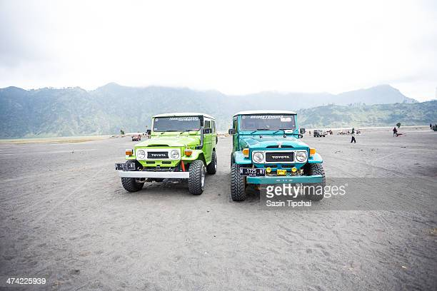 Group of tourist jeep are waiting for their customer at mount Bromo on on February 16 2014 in Bromo Volcano Java Indonesia