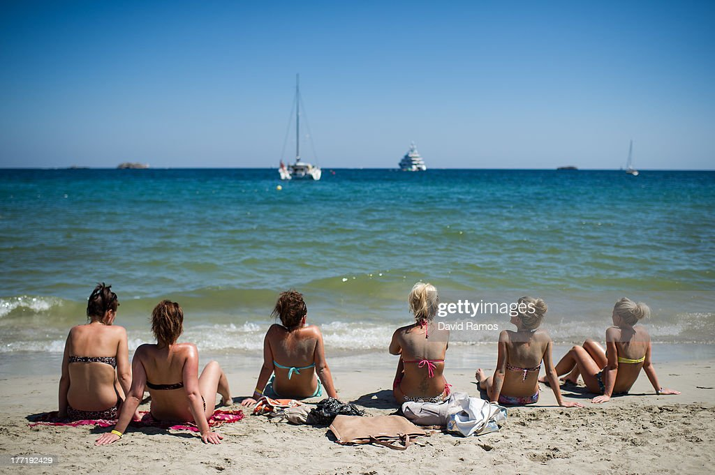 A group of tourist sunbathe at Platja d'en Bossa beach on August 21, 2013 in Ibiza, Spain. The small island of Ibiza lies within the Balearics islands, off the coast of Spain. For many years Ibiza has had a reputation as a party destination. Each year thousands of young people gather to enjoy not only the hot weather and the beaches but also the array of clubs with international DJ's playing to vast audiences. Ibiza has also gained a reputation for drugs and concerns are now growing that the taking and trafficking of drugs is spiralling out of control.