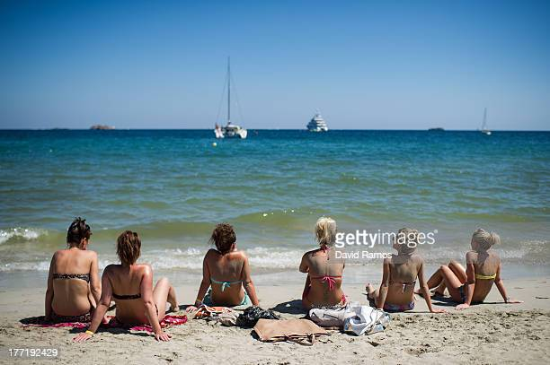 A group of tourist sunbathe at Platja d'en Bossa beach on August 21 2013 in Ibiza Spain The small island of Ibiza lies within the Balearics islands...