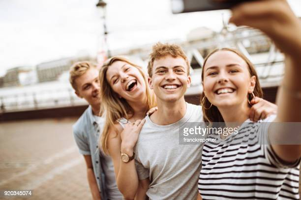 group of tourist take a selfie at tower bridge