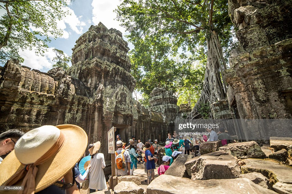 Group of tourist  visiting the Ta Prohm temple, Angkor, Cambodia : Stock Photo