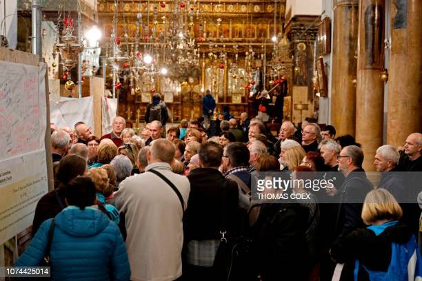 A group of tourists and pilgrims visit the Church of the Nativity the place where Jesus is said to have been born in the occupied biblical West Bank...