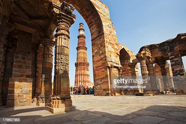 Group of tourists at Qutub Minar Delhi India