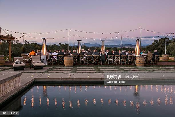 A group of tourists enjoy an early evening Russian River Valley Wine Country dinner on September 25 near Healdsburg California The annual grape...