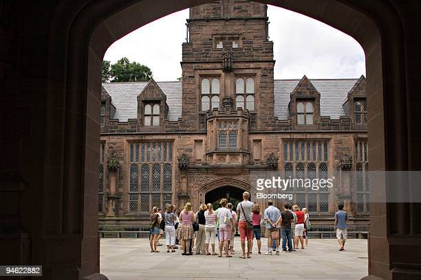 Group of tourists gathers inside the court yard of East Pyne Hall on the Princeton University campus in Princeton, New Jersey, Friday, August 8,...