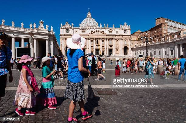 S SQUARE VATICAN CITY VATICAN Group of tourists in the square with main façade and dome of St Peter's Basilica at back