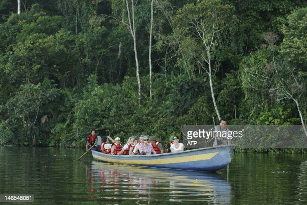 A group of tourists is seen on a boat at the Limoncoha lake next to the Yasuni Ecuadorean National Park in the Orellana ProvinceEcuador on June 16...