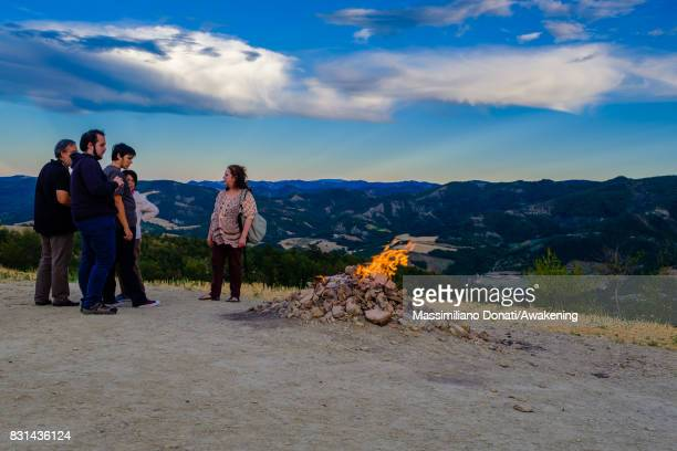 A group of tourists look the volcano's flame coming out from the subsoil on August 14 2017 in Forli Italy The volcano of Monte Busca is the smallest...