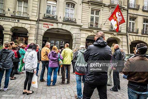 Group of tourists looking at Einstein Hause, Bern, Switzerland