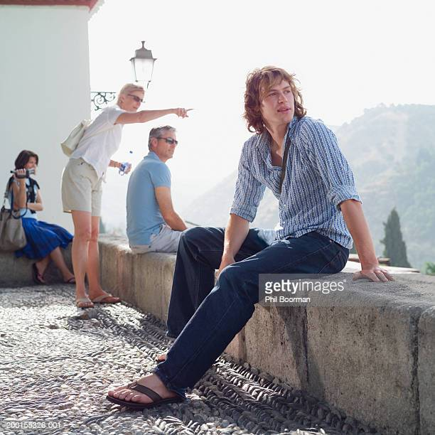 group of tourists on rooftop (focus on man in foreground) - pointing at camera stock photos and pictures
