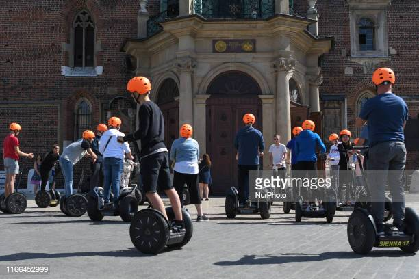 Group of tourists on Segway in front of St. Mary's Basilica, in Krakow. On Thursday, September 5 in Krakow, Poland.