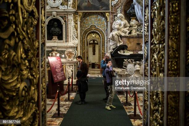 A group of tourists visit the St John's CoCathedral one of the finest examples of Baroque architecture on December 7 2017 in Valletta Malta Valletta...