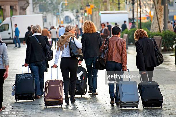 Group of tourists with suitcases in Barcelona
