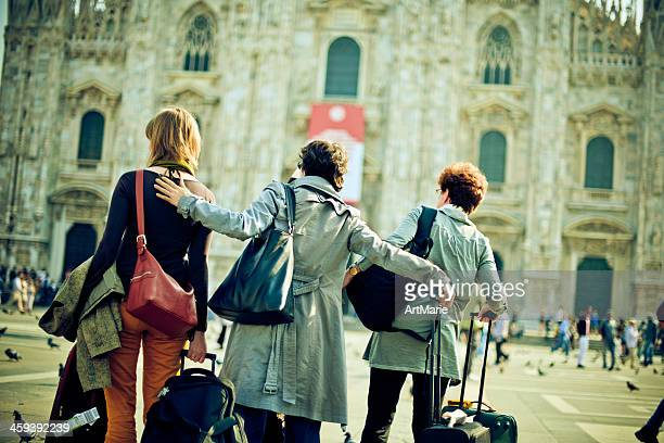 Group of tourists with suitcases in Milan, Italy