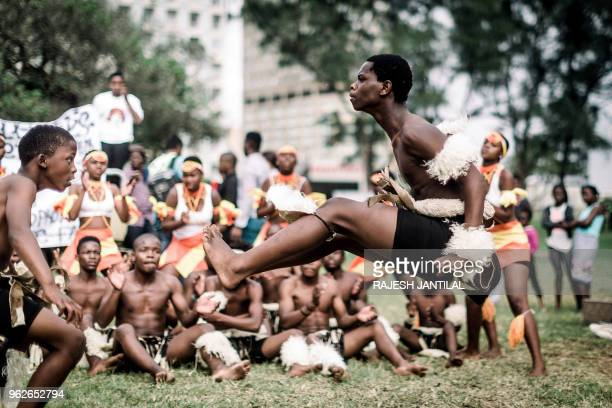 A group of traditional Zulu dancers take part on May 26 2018 in a street carnival festival in Durban celebrating Africa Month a month that sees...