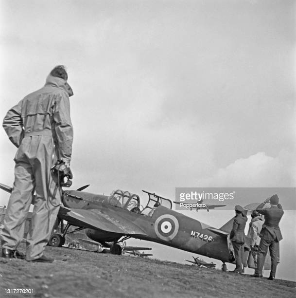 Group of trainee Royal Air Force pupil instructor pilots watch one of their colleagues take off from the runway for a training flight at a RAF School...