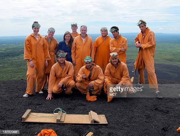 A group of travellers pose for a photo before plunging the nearly 2000 feet down the slope of Nicaragua's Cerro Negro volcano