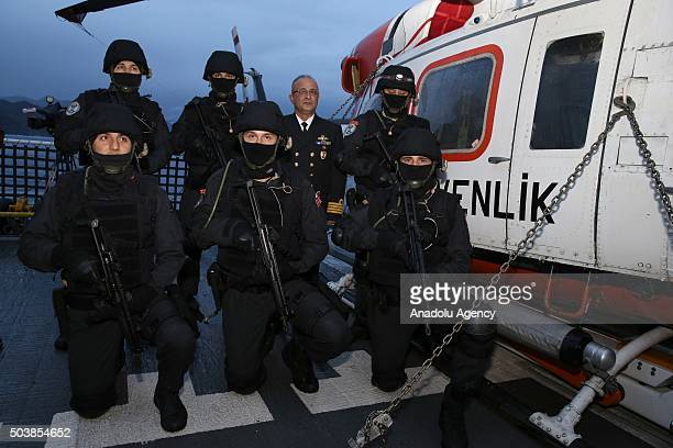 A group of Turkish naval soldiers pose at Turkish naval Ship 'TCSG Yasam' in the port of Marmaris District of Turkey's Mugla province on January 7...