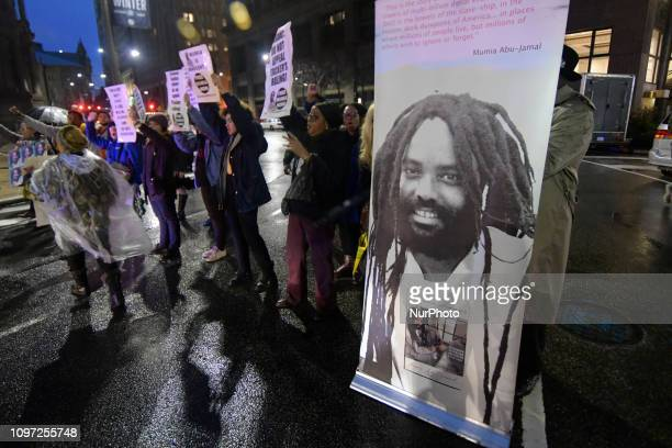 A group of two dozen activist briefly block traffic during a rally outside the District Attorney Office in Center City Philadelphia PA on December 12...
