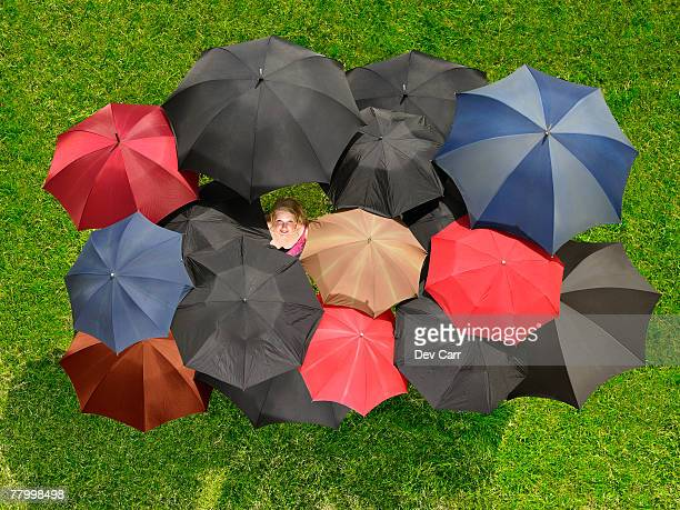 Group of umbrellas from above with one face looking up