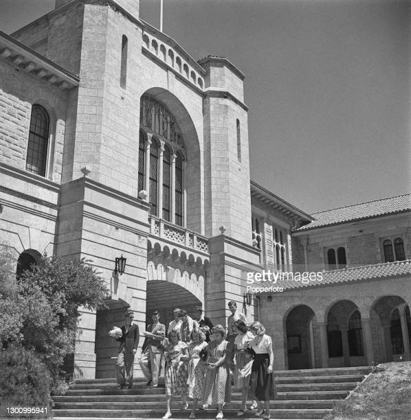 Group of undergraduate students walk down steps in front of Winthrop Hall located on the campus at the University of Western Australia in Perth,...