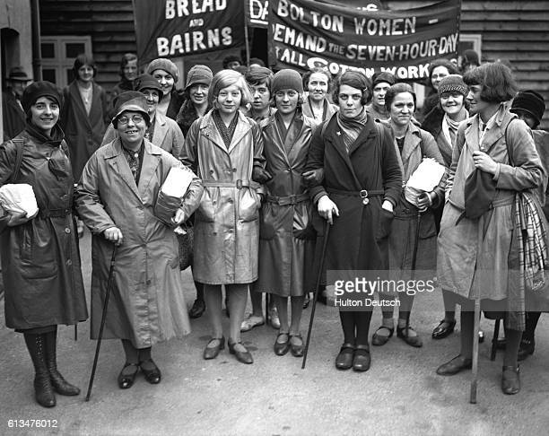 A group of unemployed women on a hunger march to London for the 1939 May Day celebrations On the banners the slogans read 'Bread and Bairns' and...