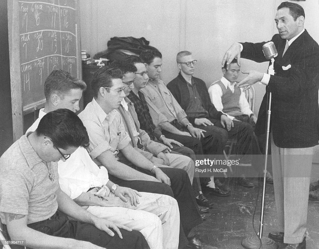 DEC 2 1954, DEC 3 1954; A group of University of Denver students are shown in various stages of hypnotic sleep during an experiment conducted at the downtown campus Thursday by Dr. Arthur Ellen, hypnotist and entertainer.;