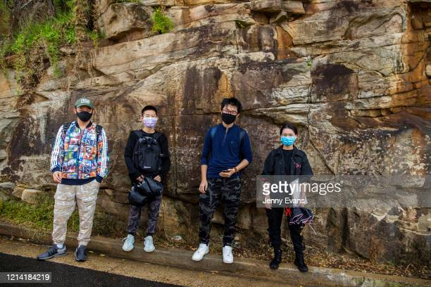 Group of University of New South Wales students pose for a photo at Bronte Beach where they are studying rock formations on March 23, 2020 in Sydney,...