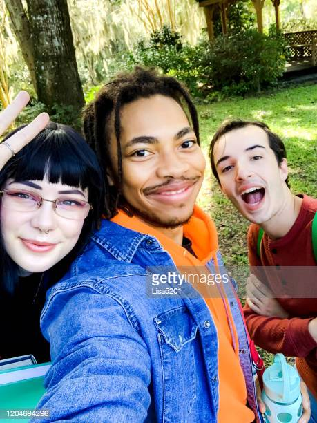 group of university students take a selfie making funny faces - purity stock pictures, royalty-free photos & images