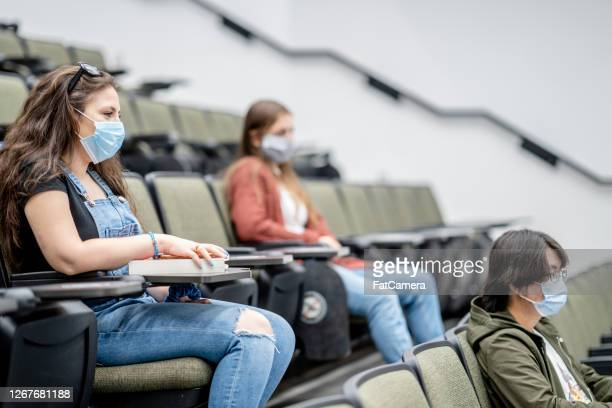 group of university students wearing masks in class - fatcamera stock pictures, royalty-free photos & images