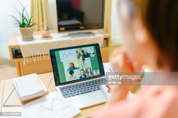 group of university students with their professor studying via conference call - illness prevention stock pictures, royalty-free photos & images
