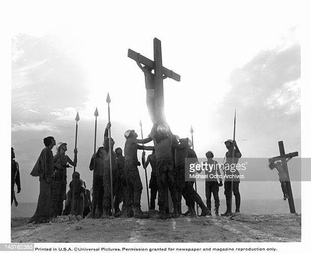 Group of unknown actors are looking up at a man nailed to a cross in a scene from the film 'Jesus Christ Superstar', 1973.