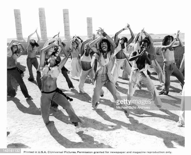 Group of unknown actors dancing in the sand in unison in a scene from the film 'Jesus Christ Superstar', 1973.