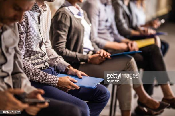 group of unrecognizable candidates waiting for a job interview. - recruitment stock pictures, royalty-free photos & images