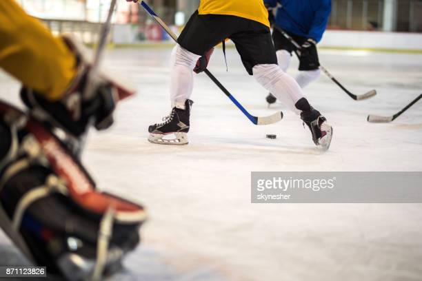 group of unrecognizable ice hockey players in action at ice rink. - sports league stock pictures, royalty-free photos & images