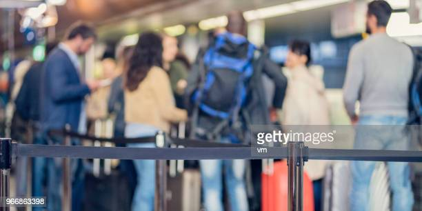 group of unrecognizable people waiting at airport check-in - emigration and immigration stock pictures, royalty-free photos & images
