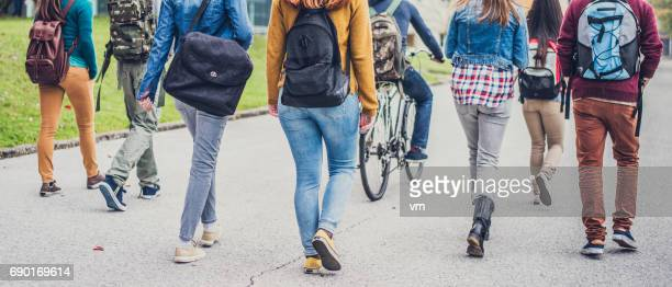group of unrecognizable sudents walking through the park - high school musical: the musical: the series stock photos and pictures